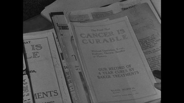 Headquarters Chicago Beware of quack poster Dr Fishbein saying there is no cure for Cancer Woman in card files of 'quacks' FAKE CURES booklets...