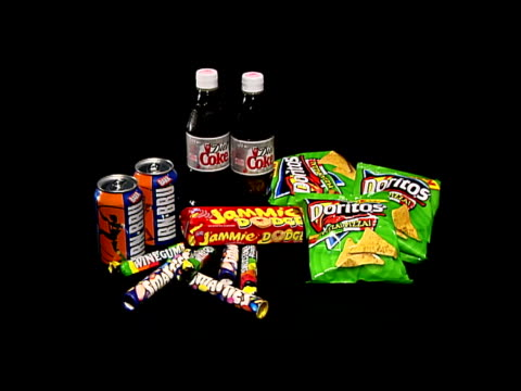 Food Additives warning ITN ENGLAND London GIR Selection of crisps sweets drinks PAN