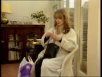 Occupational Asthma aNAO ENGLAND SEQ Woman seated in chair using inhaler U21039501 ITN