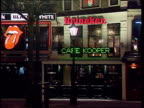 Amsterdam 'Canabis Cup' Concert GVs shoppers to fro in high street with brass band playing Vox pops on cannabis People at bar in coffee shop CS price...