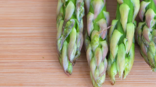 Healthy Eating: asparagus, raw food over wooden background.