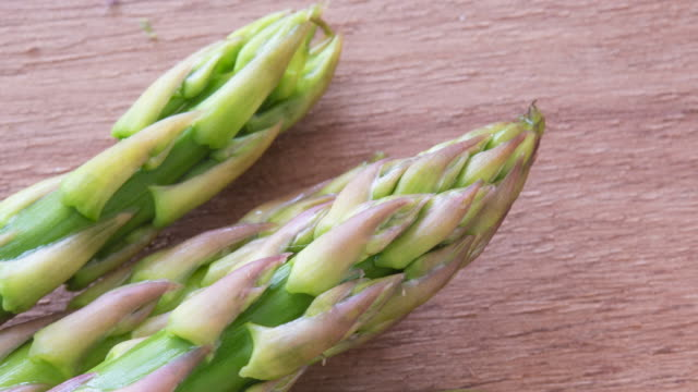 Healthy Eating: Zoom in to fresh asparagus over a cutting board. Real imperfect food ingredients