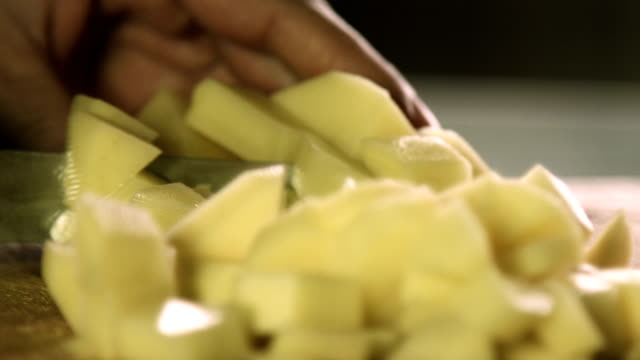 healthy fresh food prep cutting up of vegetable potato