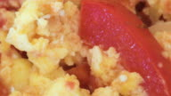 Healthy high protein food: macro of scrambled eggs with red bell peppers