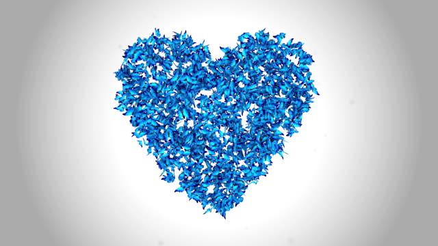 Herzsymbol hergestellt mit blauen Schmetterlinge-Alpha