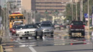 Heat waves distort vehicles traveling on streets.