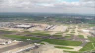 Heathrow Airport aerials AIR VIEWS / AERIALS Heathrow Airport with British Airways aircraft parked at gates taxiing taking off and landing GOOD