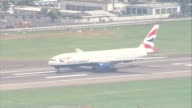 London Heathrow Heathrow Airport with British Airways aircraft parked at gates taxiing taking off and landing GOOD