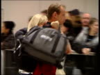 Heathrow Airport Two crying female passengers along at airport on arrival home PAN CMS Two women hugging MS Family group hugging Great Yarmouth BV MS...