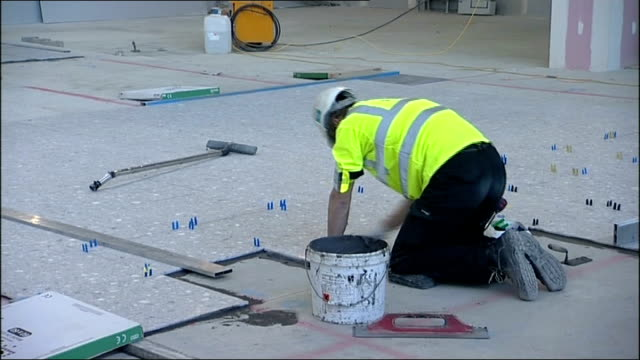 Official opening date for Terminal 2 announced ENGLAND Middlesex Heathrow Airport EXT High Angle GV of construction site of Terminal 2 Worker on...