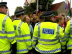 climate change campaigners protest General views of police surrounding protestors trying to talk to police / More views of closedin protestors as...