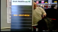 Heathrow security breach LIB INT Liquid display sign 'Additional searches prior to checkin BAA Heathrow' BV Passengers queuing with luggage at...