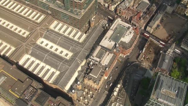 London aerials ENGLAND London People sunbathing beside swimming pool on roof terrace of Shoreditch House/ City of London financial district and...