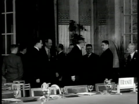 Heavily guarded Brussels street Belgium INT VS US Secretary of State Dean G Acheson other Foreign Ministers entering room VS Members around table in...