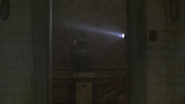 MS Heavy armored policeman SWAT like enters room with flashlight