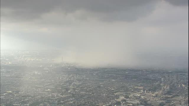 Heavy clouds dump rain over Tokyo.