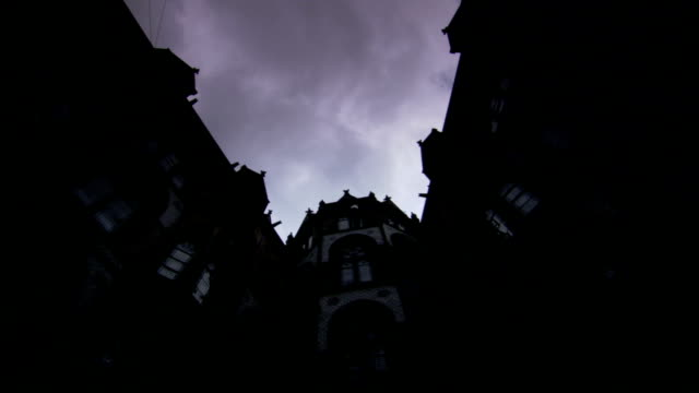 Heavy clouds flow over the Manchester Town Hall in Manchester, England at dusk. Available in HD.
