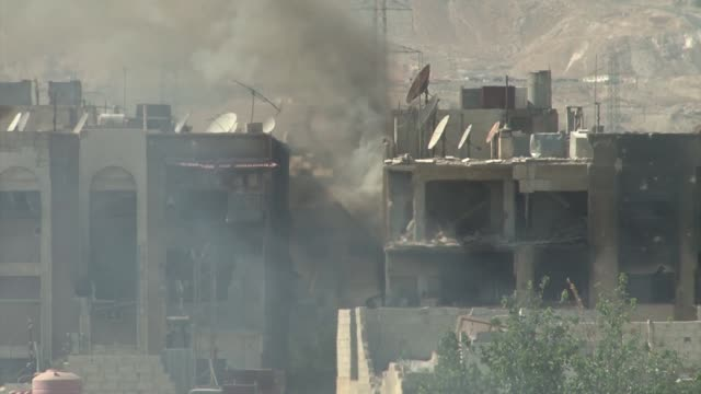 Heavy fighting in Damascus between Syrian Arab Army and AlNusra front AlQabun district Tank battles and explosions ruined buildings blown to pieces