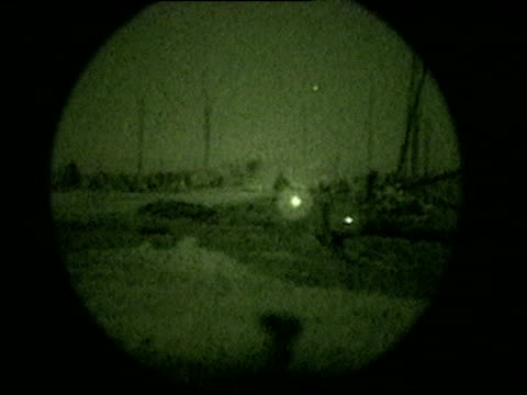 Heavy gunfire rains over soldiers during the Iraq War 21 Mar 03