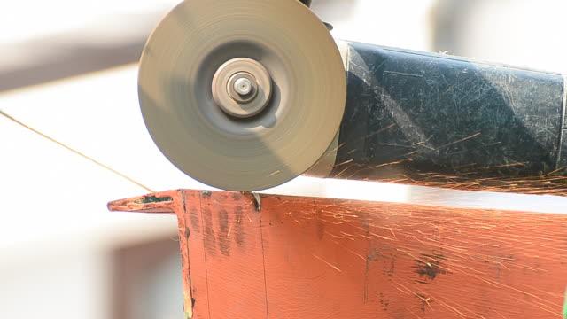 Heavy industry worker cutting steel