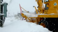 Heavy machinery clears streets of snow as major blizzard hits northern Japan