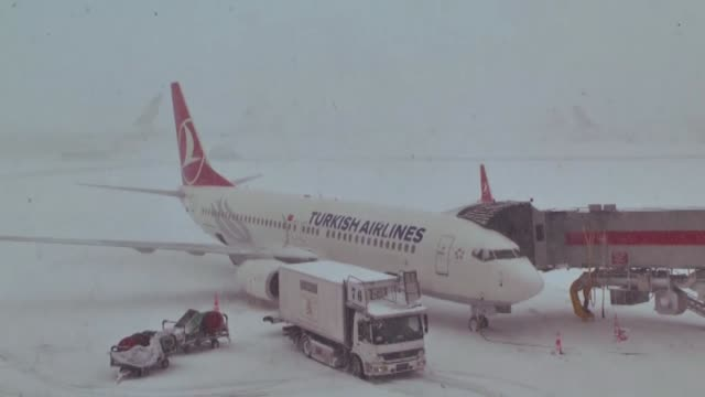 Heavy snowfall causes flight cancellations at Istanbul Ataturk Airport as extreme weather conditions blast Turkey's biggest city on February 18 2015...