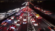 TL / Heavy traffic at rush hour on motorway entering a capital city