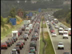 Heavy traffic crawling on motorway in heat haze, UK