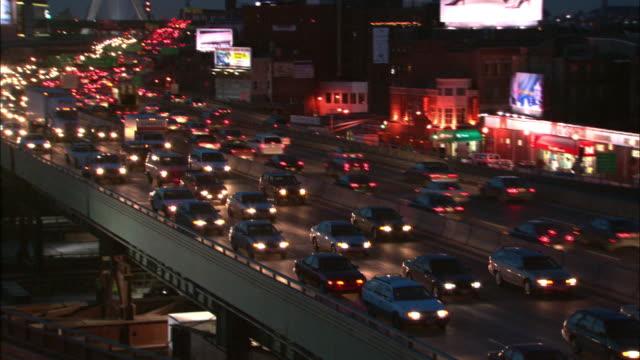 Heavy traffic moves along Boston's Big Dig at night.