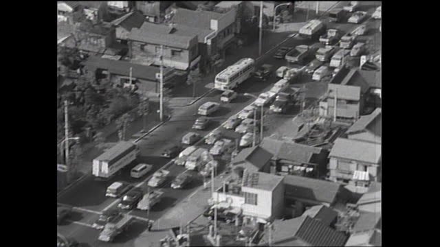 Heavy traffic moves slowly on the Tokyo urban beltway No7 / Shot at somewhere in Tokyo on October 5 1965