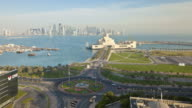 Heavy traffic moves through a roundabout near Dhow Harbor.