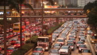 WS HA Heavy traffic on downtown freeway at dusk / Hong Kong, China
