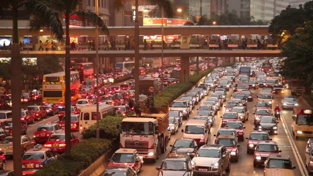 WS HA Heavy traffic on downtown freeway at dusk / Hong Kong, China