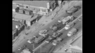 Heavy traffic passes each other on the Keiyo Road in Tokyo / Shot at Edogawa area in Tokyo on October 5 1965