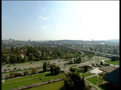 Heavy traffic travelling over various bridges into city Belgrade