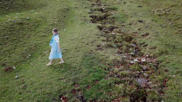 'Heidi' girl in blue dress on a alpine meadow in autumn