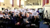 May and Pickles speeches to the Board of Deputies of British Jews People at service holding up signs reading 'Je Suis Juif' and 'Je Suis Charlie' and...