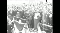 Helen Schafer sings 'The Star Spangled Banner' at the opening ceremony for Floyd Bennett Field in Brooklyn New York City Mayor Jimmy Walker stands...