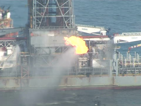 Helicopter aerials of oil recovery site of DeepWater Horizon crude oil spill / aerials of the ship Discoverer Enterprise and the rigs drilling relief...