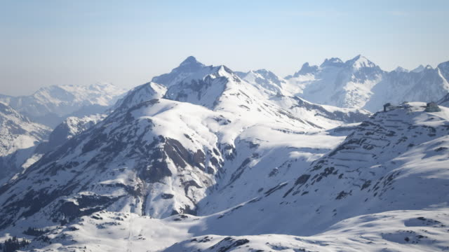 Helicopter flight through snow-covered mountains
