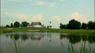 WS Helicopter flying over pond near club house at golf resort / Queenstown, Maryland, USA