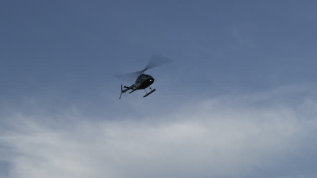 Helicopter flying through the air near NYC skyline