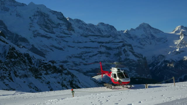 Helicopter landing on Mannlichen, Grindelwald, Bernese Alps, Switzerland, Europe