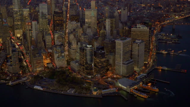 helicopter shot of new york city battery park skyline at night