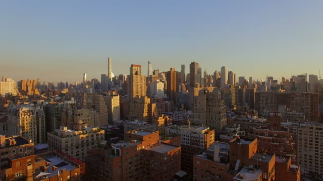 helicopter shot of new york city skyline landmark at sunset