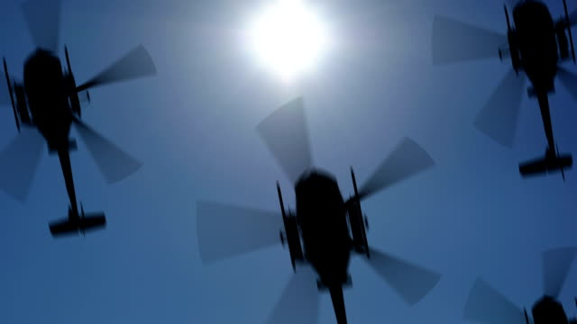 Helicopter silhouette in the sky. Seamless loop, HD