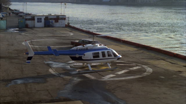 WS PAN Helicopter taking off and flying over city and river / New York City, New York State, USA