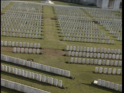 Helicopter view over rows of white headstones zoom out to show extent of cemetery Somme