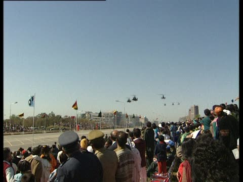 Helicopters fly over crowds in Islamabad for National Day Parade