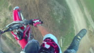 POV helmet cam view of motocross motorcycle riding and doing a jumping trick. - Slow Motion - 1920x1080